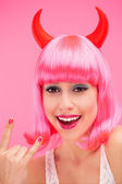 Woman wearing devil horns — Stock Photo