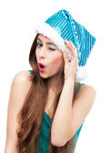 Woman in Christmas hat winking — Stock Photo