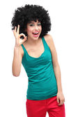Woman with afro showing OK sign — ストック写真