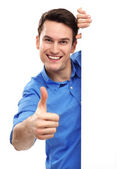 Man with blank poster showing thumbs up — Stock Photo