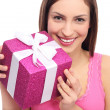 Smiling woman holding gift — Stock Photo
