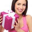 Smiling woman holding gift — Stockfoto