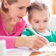 Foto Stock: Mother and daughter drawing