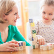 Mother and daughter playing with blocks - Foto Stock