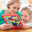 Mother and daughter with abacus — Stok fotoğraf