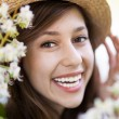 Smiling woman with flowering tree — Stock Photo