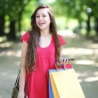 Stock Photo: Young womwith shopping bags