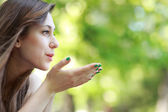 Young woman blowing a kiss — Stock Photo
