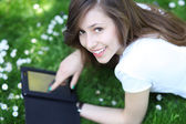 Woman using digital tablet outdoors — Stock Photo