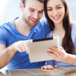 Couple using digital tablet — Stock Photo #25790545