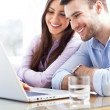 Business couple using laptop — Stock Photo