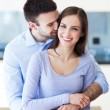 Stock Photo: Young couple hugging at home