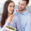 Couple in modern kitchen — Stock Photo