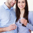 Couple with glasses of water — Stock Photo