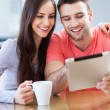 Smiling couple with digital tablet — Stok fotoğraf