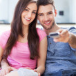 Couple with TV remote — Stock Photo