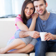 Young couple on sofa — Stock Photo