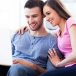 Couple on sofa with laptop — Stock Photo