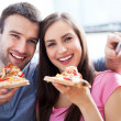Couple with pizza and TV remote — Stock Photo #25792965
