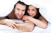 Young couple in bed — Foto Stock