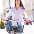 Woman riding a bike in the city — Stock Photo #26889969