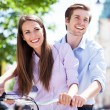 Young couple on bike — Stock Photo #26889989