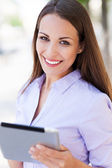 Woman with digital tablet — Stock Photo