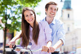 Young couple on bike — Stok fotoğraf