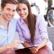 Couple using digital tablet — Stock Photo #26890039