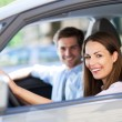 Young couple sitting in car — Foto Stock #26890281
