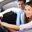 Young couple sitting in car — Stockfoto #26890421