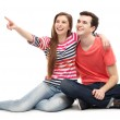 Young couple pointing — Stock Photo #27025423