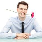 Businessman biting flower — Stock Photo #27026327