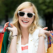 Young smiling woman with shopping bags — Stock Photo #27029527