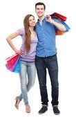 Pár s nákupní tašky — Stock fotografie