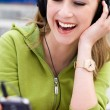 Young woman listening to music — Stock Photo #27030007