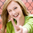 Girl Making Peace Sign — Stock Photo #27030947
