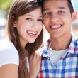 Teenage couple with mp3 player — Stock Photo #27032371