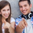 Young couple pointing — Stock Photo #27037075