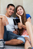 Teenage couple with digital tablet — Stock Photo