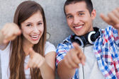 Young couple pointing — Stock Photo