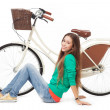 Woman with her bike — Stock Photo #27197339