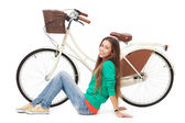 Woman with her bike — Stock Photo