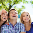 Three young friends pointing — Stock Photo