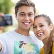 Couple taking photo of themselves — Stock Photo