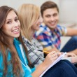 Three students sitting together — Stock Photo