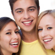 Young man with two female friends — Stock Photo #27214861