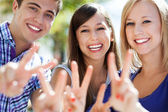 Young showing peace sign — Stock Photo