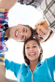 Friends in a huddle — Stock Photo