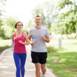 Couple Exercising In Park — Stock Photo